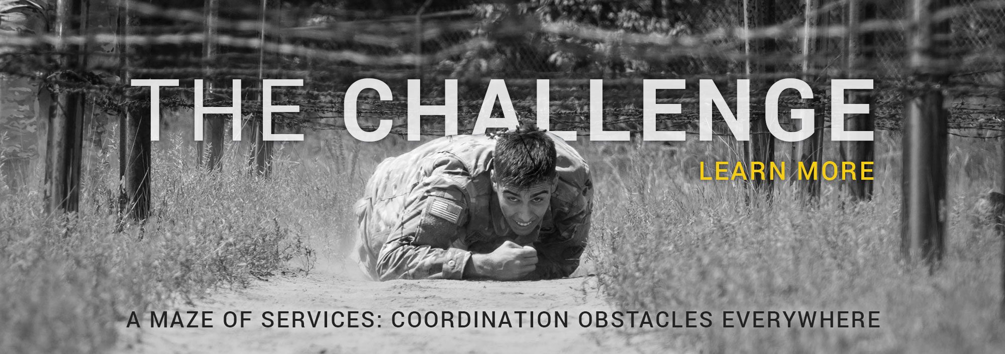 The Challenge - soldier crawling under barbed wire in training